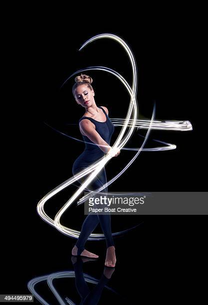 Dancer making elegant light waves around her
