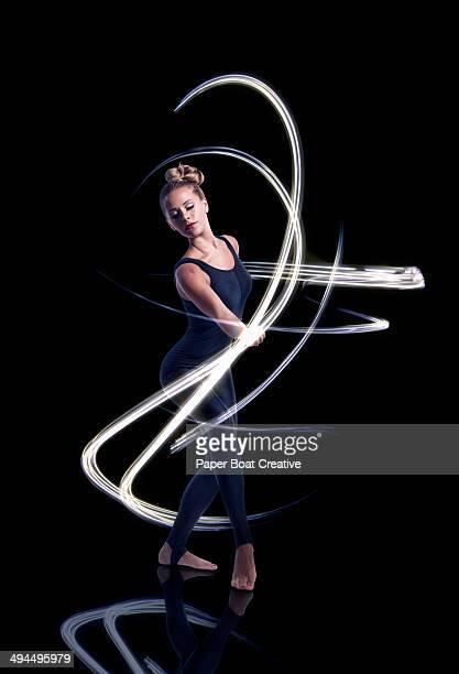 Dancer making elegant light waves around her