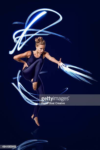 Dancer making fast motions with strong blue light