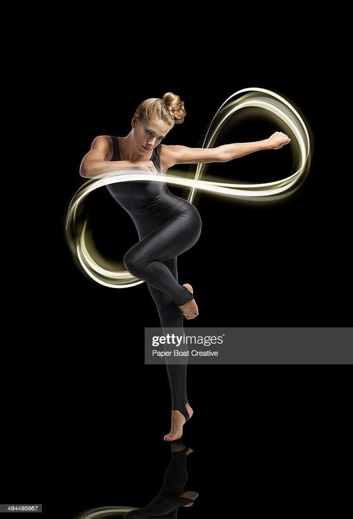Dancer making light motion forming infinity