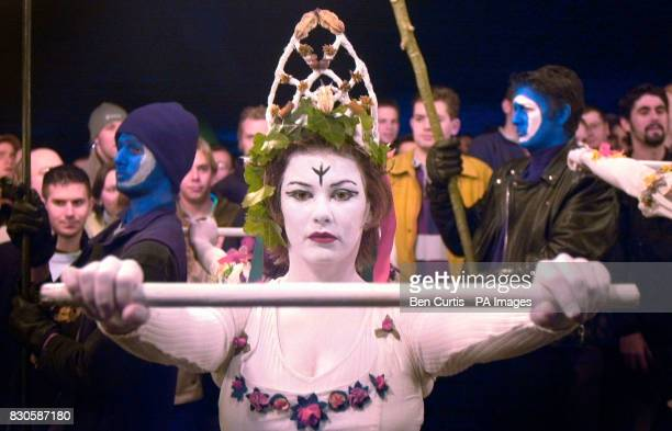 A dancer marches on the top of Calton Hill in Edinburgh as part of the Beltane fire festival