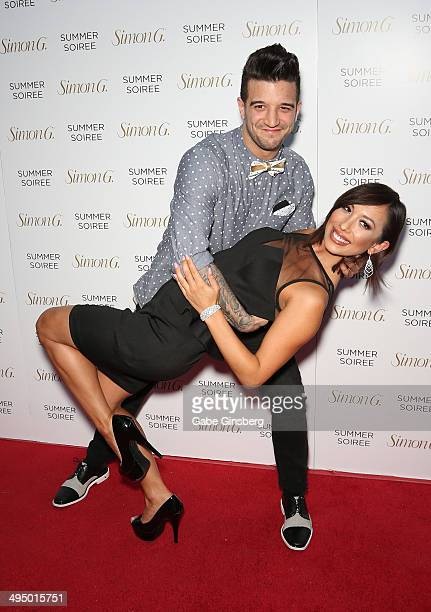 Dancer Mark Ballas and dancer/model Cheryl Burke perform a dance move as they arrive at the Simon G Soiree at the Four Seasons Hotel Las Vegas on May...