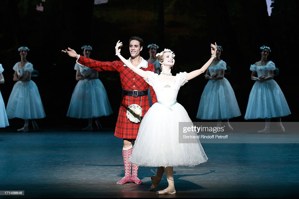 Dancer Mathias Heymann (L) and Main Dancer of Bolchoi Evgenia Obrastzova perform at Gala of AROP at Opera Garnier with representation of 'La Sylphide' on June 24, 2013 in Paris, France.