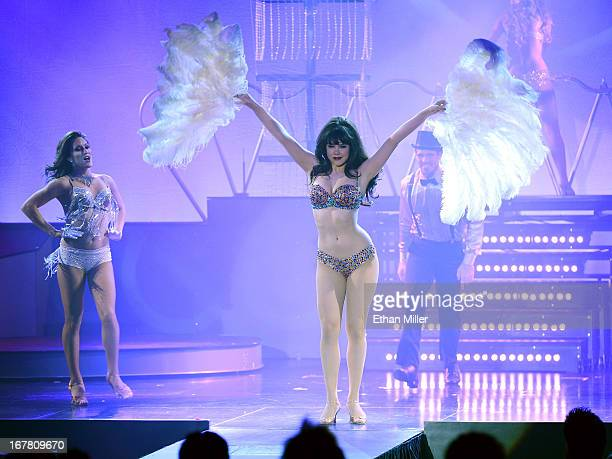 Dancer Megan Kovitch model Claire Sinclair and dancer Ryan Kelsey perform during the premiere of the show 'Pin Up' at the Stratosphere Casino Hotel...