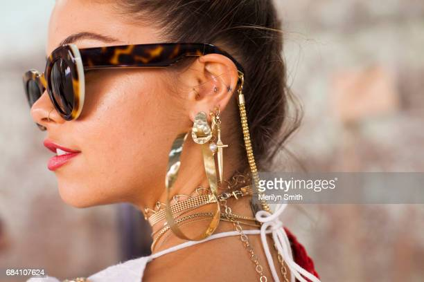 Dancer Model and Social Influencer Mimi Elashary wearing Pamela Love and Maniamania jewellery and Lucy Folk sunglasses during MercedesBenz Fashion...