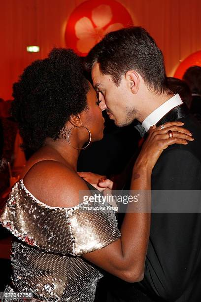 Dancer Motsi Mabuse and friend attend the Mon Cheri Barbara Tag at Postpalast on December 2 2016 in Munich Germany