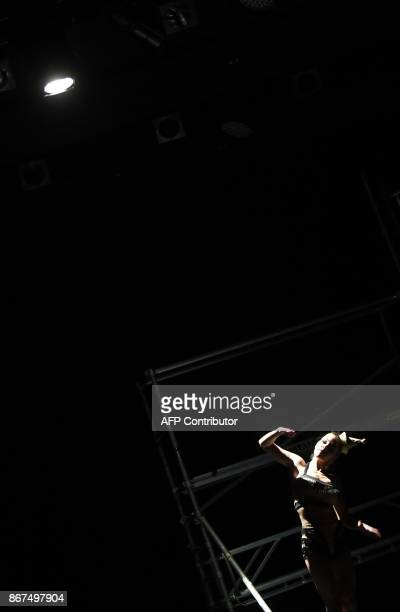 A dancer of a Hungarian contemporary group with classical ballet basics the 'Kulcsar Noemi Tellabor' group Kitti Hajszan performs on the stage of the...