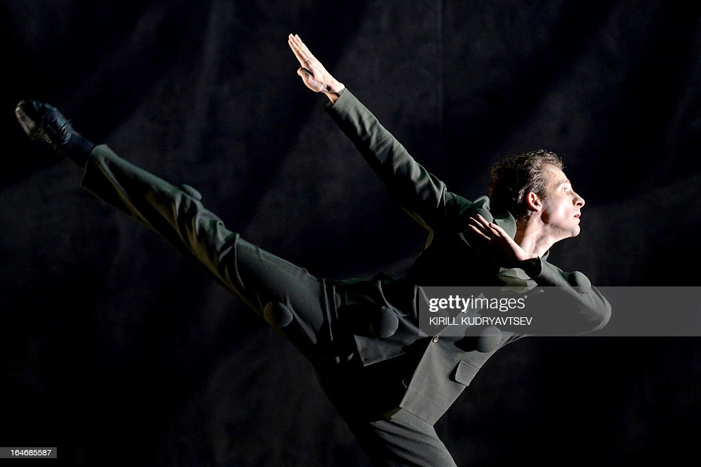 A dancer of the Bolshoi ballet performs during a rehearsal for a 'Appartment' by Sweden's choreographer Mats Ek at the Bolshoi Theatre in Moscow on March 26, 2013, on the eve of the premiere of this ballet. 'Appartment' will open on March 28 a ballet fest entitled 'The Century of 'The Rite of spring' - Century of modernism', running until April 21 at the Bolshoi Theater.