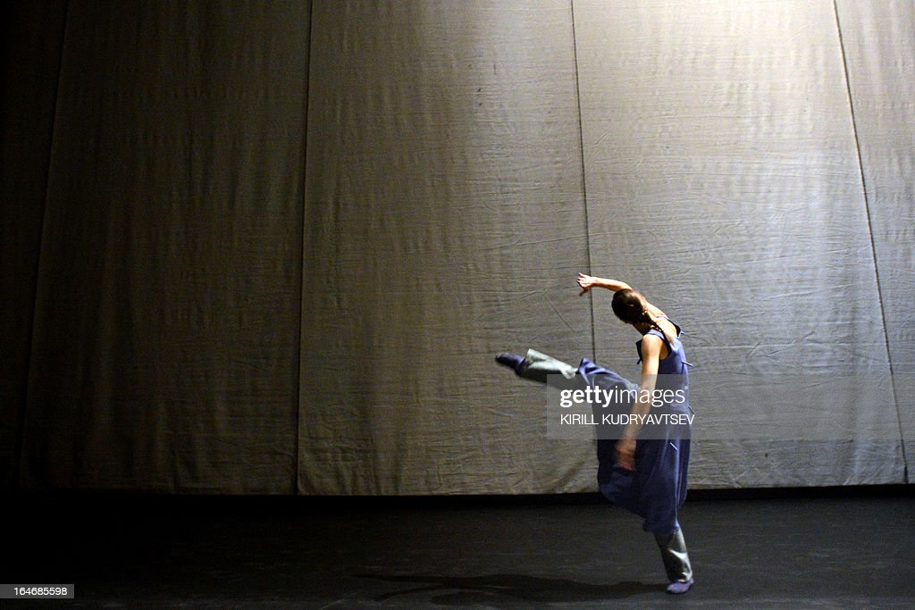 A dancer of the Bolshoi ballet performs during a rehearsal for a 'Appartment' by Sweden's choreographer Mats Ek at the Bolshoi Theatre in Moscow on March 26, 2013, on the eve of the premiere of this ballet. 'Appartment' will open on March 28 a ballet fest entitled 'The Century of 'The Rite of spring' - Century of modernism', running until April 21 at the Bolshoi Theater. AFP PHOTO / KIRILL KUDRYAVTSEV