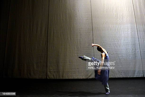 A dancer of the Bolshoi ballet performs during a rehearsal for a 'Appartment' by Sweden's choreographer Mats Ek at the Bolshoi Theatre in Moscow on...