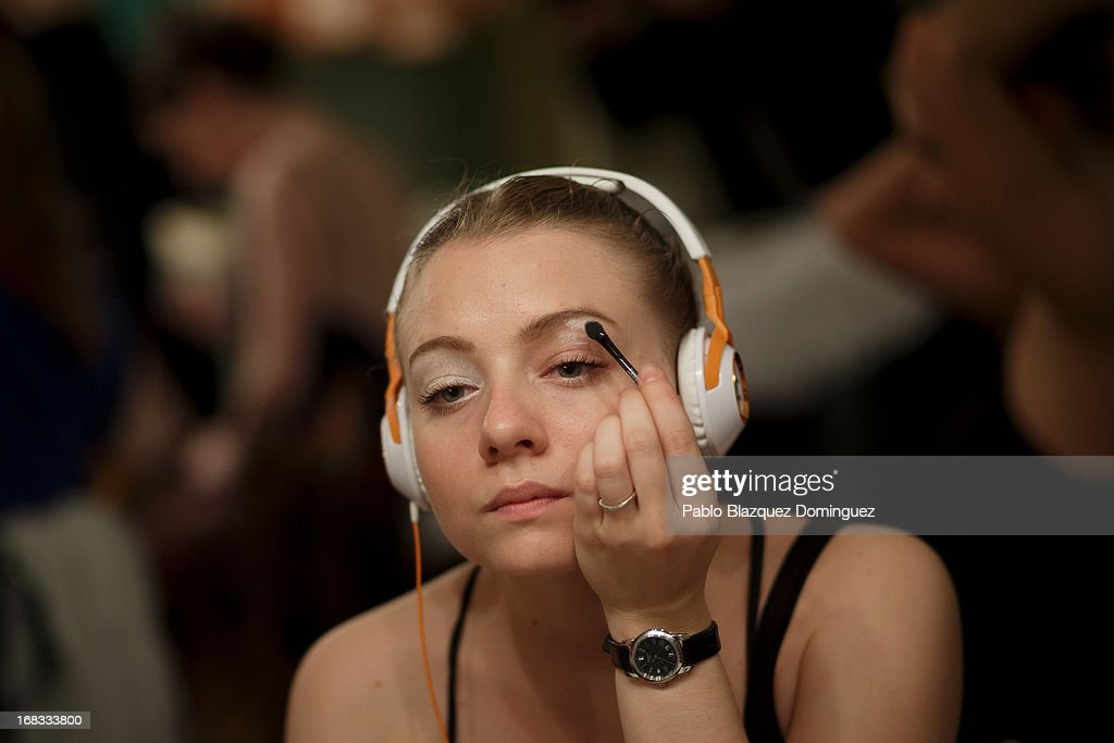 A dancer of the Classical Russian Ballet applies make-up at backstage before a rehearsal of 'Swan Lake' at Nuevo Apolo Theatre on May 8, 2013 in Madrid, Spain.