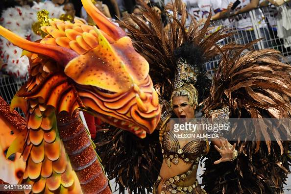 TOPSHOT A dancer of the Mocidade Alegre samba school performs during the first night of carnival parade at the Sambadrome in Sao Paulo Brazil on...