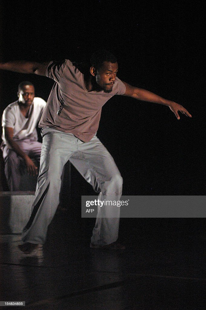 A dancer of the Revolution company performs 'Rage' by French choreographer Anthony Egea at the French Institute in Libreville on October 17, 2012. Six dancers from six African countries -- Mali, Congo, Gabon, Comoros, Central Africa, and Burkina Faso -- dance 'Rage', a show mixing hip-hop, krump, contemporary and traditional dance on tour in French Institutes in Africa before coming to Europe in 2013.