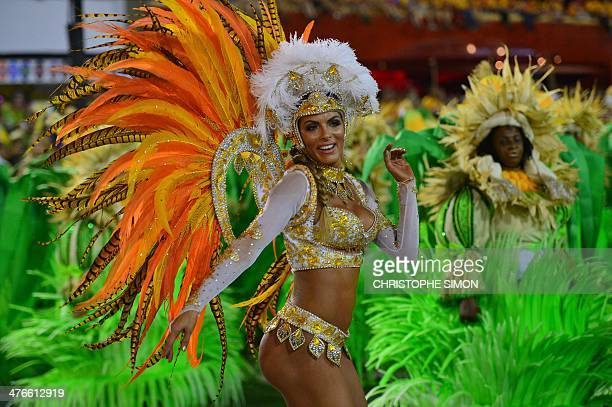 A dancer of the Vila Isabel samba school performs during the second night of carnival parade at the Sambadrome in Rio de Janeiro on March 4 2014 AFP...