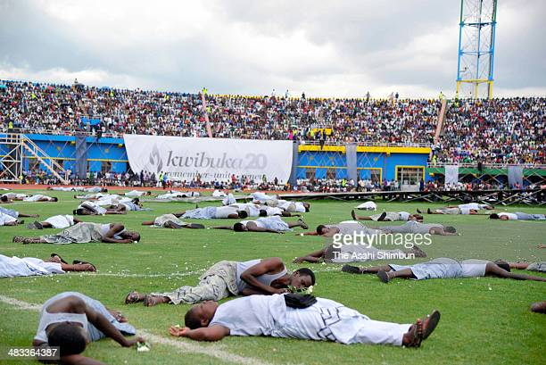 Dancer perform to portray the genocide during the 20th anniversary commemoration of the 1994 genocide at the Amahoro Stadium on April 7 2014 in...