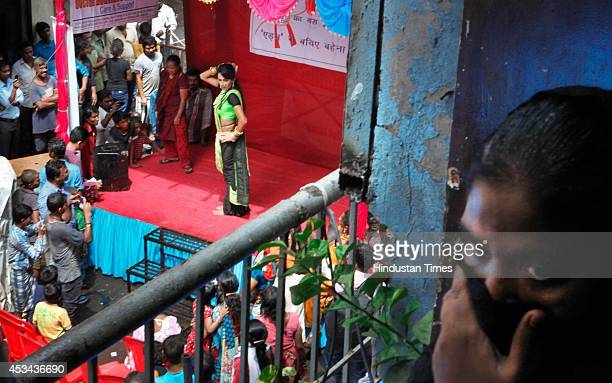 A dancer performs and entertains the sex workers during an event held on the occasion of Raksha Bandhan organized by the NGO Social Activities...
