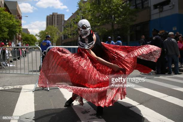 A dancer performs as activists hold signs and chant slogans against Paul Ryan speaker of the United States House of Representatives visit to Harlem...