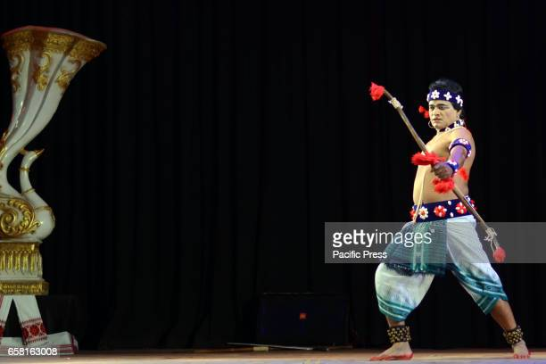 A dancer performs Chhau dance at 'Chhau Parva' organised by Sangeet Natak Akademi New Delhi in association with Kollol and Rangalaya Nagaon at Khagen...
