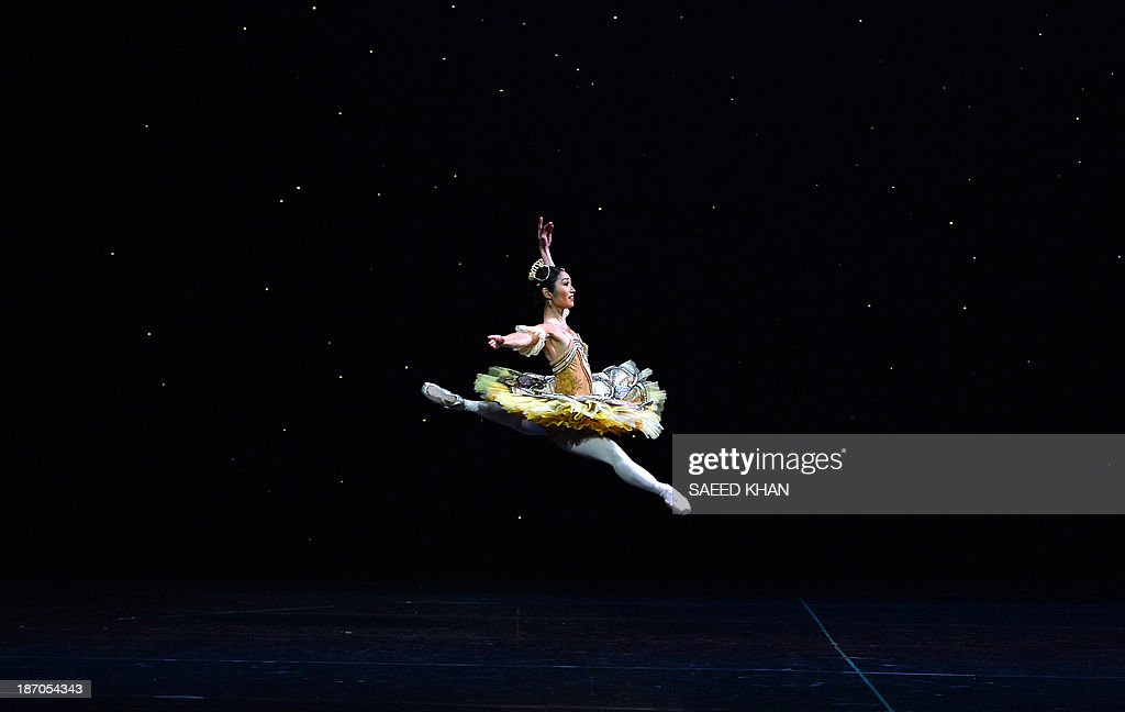 A dancer performs during a full-dress rehearsal of the Australian Ballet's performance of La Sylphide at the Opera House in Sydney on November 6, 2013. The romantic ballet from 1836 will run at the Opera House from November 7 to 25. AFP PHOTO / Saeed Khan