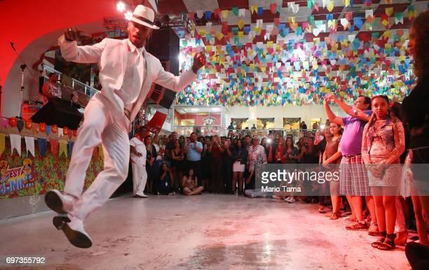 A dancer performs during a traditional Festas Juninas party at the Salgueiro samba school on June 17 2017 in Rio de Janeiro Brazil Rio Mayor Marcelo...