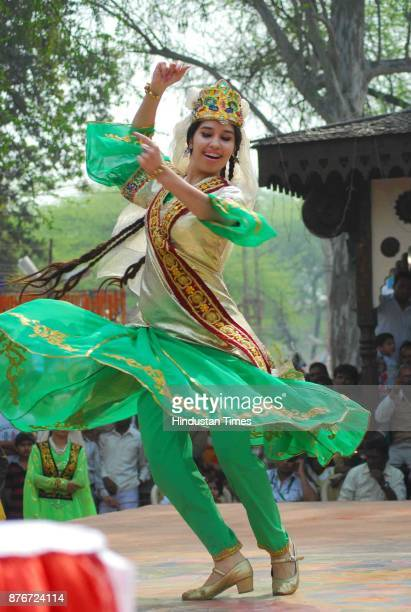 A dancer performs during Surajkund Crafts Mela organised at Surajkund in Faridabad The 15day annual event which is observing its silverjubilee...