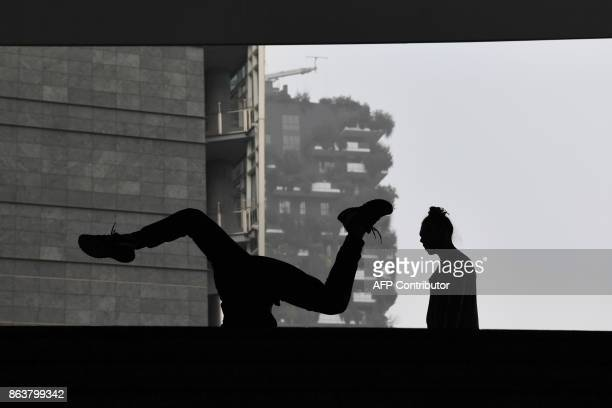 A dancer performs in Piazza Gae Aulenti in the business district in Milan on October 20 as smog has reached alarming levels in northern Italy in...