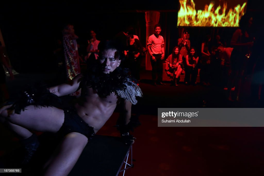 A dancer performs on a mini stage during the Official Closing Party hosted by On Aura Tout Vu on closing day of French Couture Week 2012 Singapore at The Shoppes at Marina Bay Sands on December 2, 2012 in Singapore.