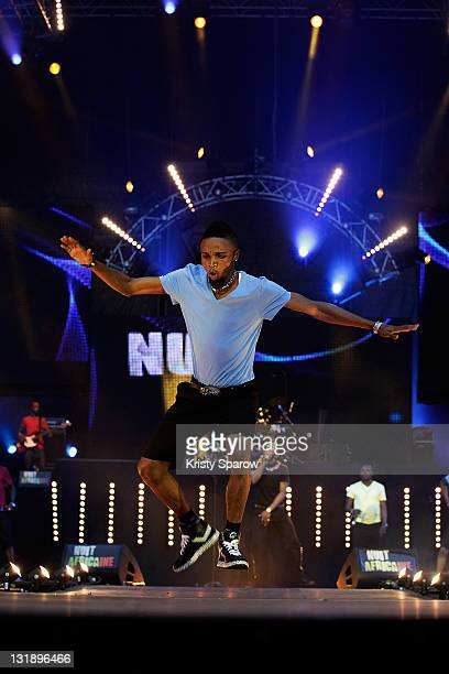 A dancer performs with Fally Ipupa on stage during the 'Nuit Africaine' concert at Stade de France on June 11 2011 in Paris France
