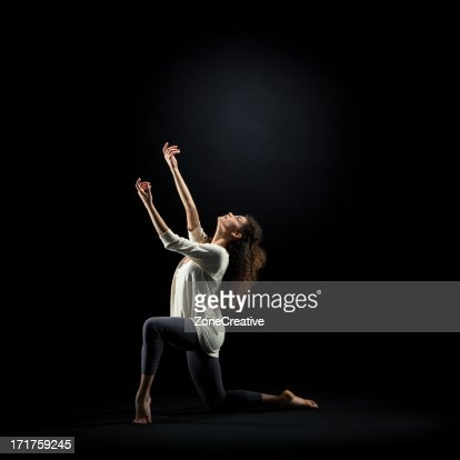 Dancer pose on black background : Stock Photo