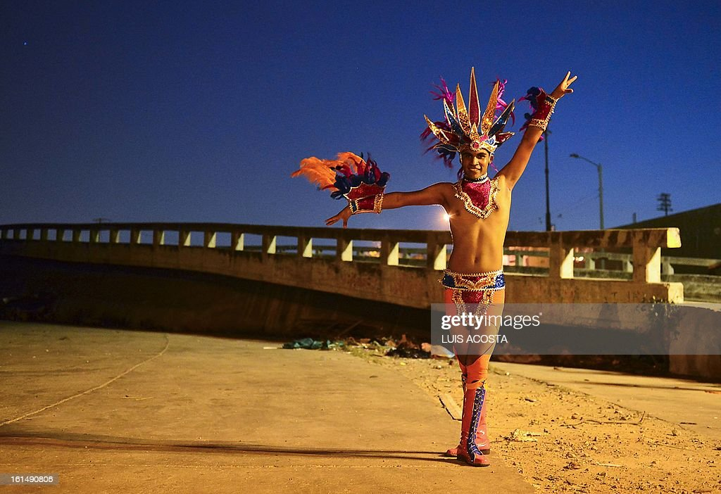A dancer poses after taking part in the third day of carnival in Barranquilla, Colombia, on February 11, 2013. Barranquilla's Carnival, a tradition created by locals at the end of the 19th century as a response and to parody the celebration held by European immigrants and aristocracy, was declared a 'Masterpiece of Oral and Intangible Heritage of Humanity' by the UNESCO in 2003. AFP PHOTO/Luis Acosta