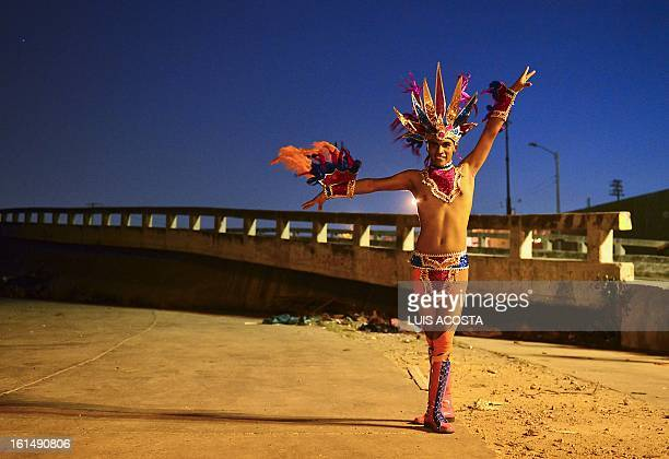 A dancer poses after taking part in the third day of carnival in Barranquilla Colombia on February 11 2013 Barranquilla's Carnival a tradition...