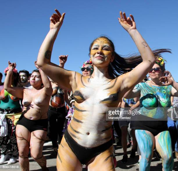 A dancer poses for a photgraph showing off her body painted during the carnival of thousand drums at Playa Ancha District on October 01 2017 in...