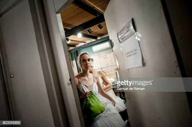 A dancer prepares backstage ahead of a rehearsal for 'El lago de Los Cisnes' on June 27 2017 in Madrid Spain
