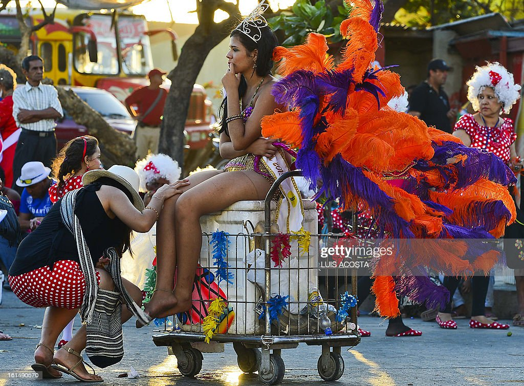 A dancer rests after taking part in the third day of carnival in Barranquilla, Colombia, on February 11, 2013. Barranquilla's Carnival, a tradition created by locals at the end of the 19th century as a response and to parody the celebration held by European immigrants and aristocracy, was declared a 'Masterpiece of Oral and Intangible Heritage of Humanity' by the UNESCO in 2003. AFP PHOTO/Luis Acosta