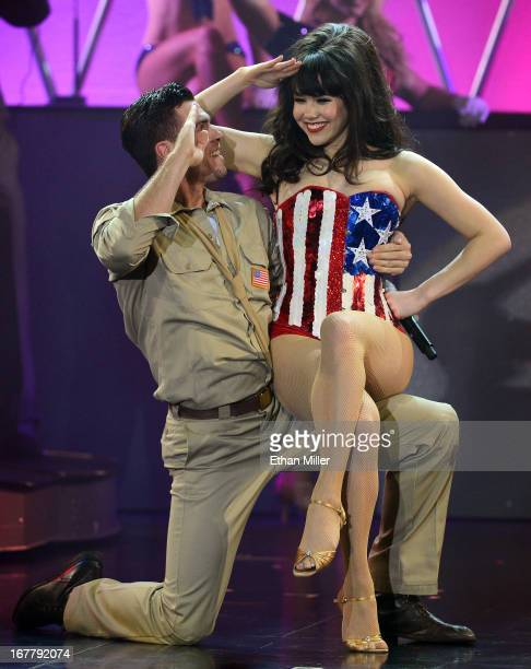 Dancer Ryan Kelsey and model Claire Sinclair perform during the premiere of the show 'Pin Up' at the Stratosphere Casino Hotel on April 29 2013 in...