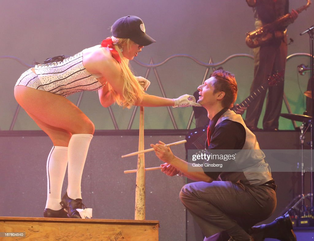 Dancer Sarah Short (L) and drummer Brian Czach perform during the premiere of the show 'Pin Up' at the Stratosphere Casino Hotel on April 29, 2013 in Las Vegas, Nevada.