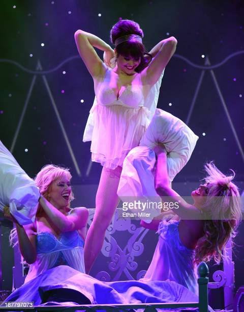 Dancer Sarah Short model Claire Sinclair and dancer Koree Kurkowski perform during the premiere of the show 'Pin Up' at the Stratosphere Casino Hotel...