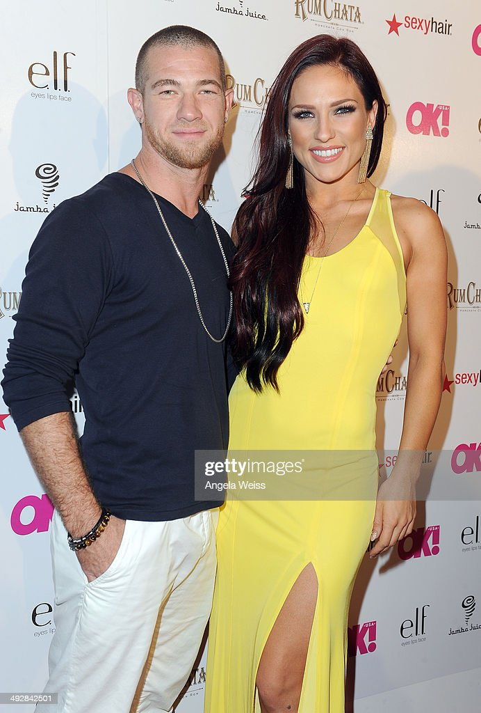 Dancer Sharna Burgess (R) and Paul Kirkland attend OK Magazine's So Sexy L.A. Event at LURE on May 21, 2014 in Los Angeles, California.