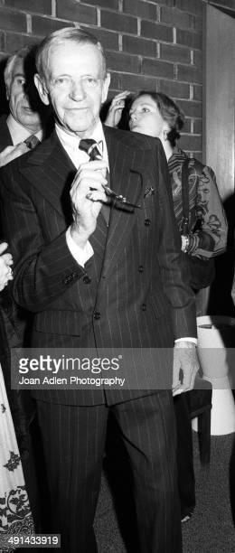 Dancer singer actor and choreographer Fred Astaire attends a showing of the television movie 'A Family Upside Down' in which he costars at the...