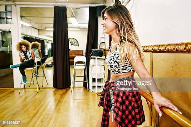 Dancer standing at bar in studio