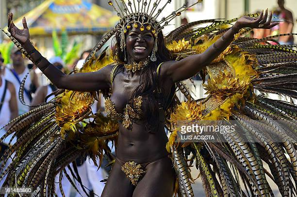 A dancer takes part in the third day of carnival parade in Barranquilla Colombia on February 11 2013 Barranquilla's Carnival a tradition created by...