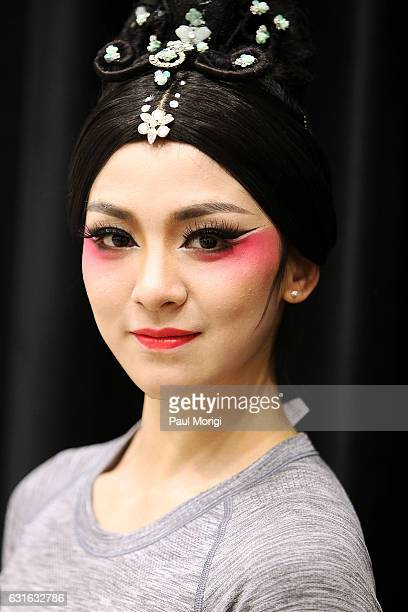 Dancer Tang Shiyi poses for a photo backstage after a special preview of The China National Opera Dance Drama Theater's production of 'Confucius' at...