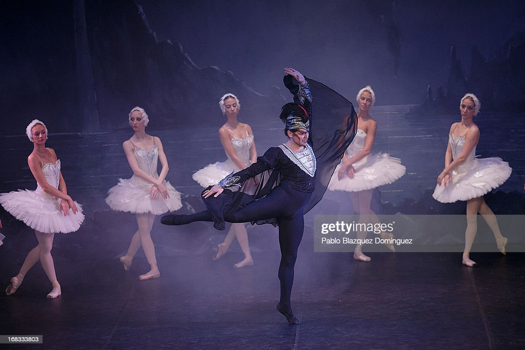 Dancer Timur Kinzikeev (C) of the Classical Russian Ballet performs during a rehearsal of 'Swan Lake' at Nuevo Apolo Theatre on May 8, 2013 in Madrid, Spain.