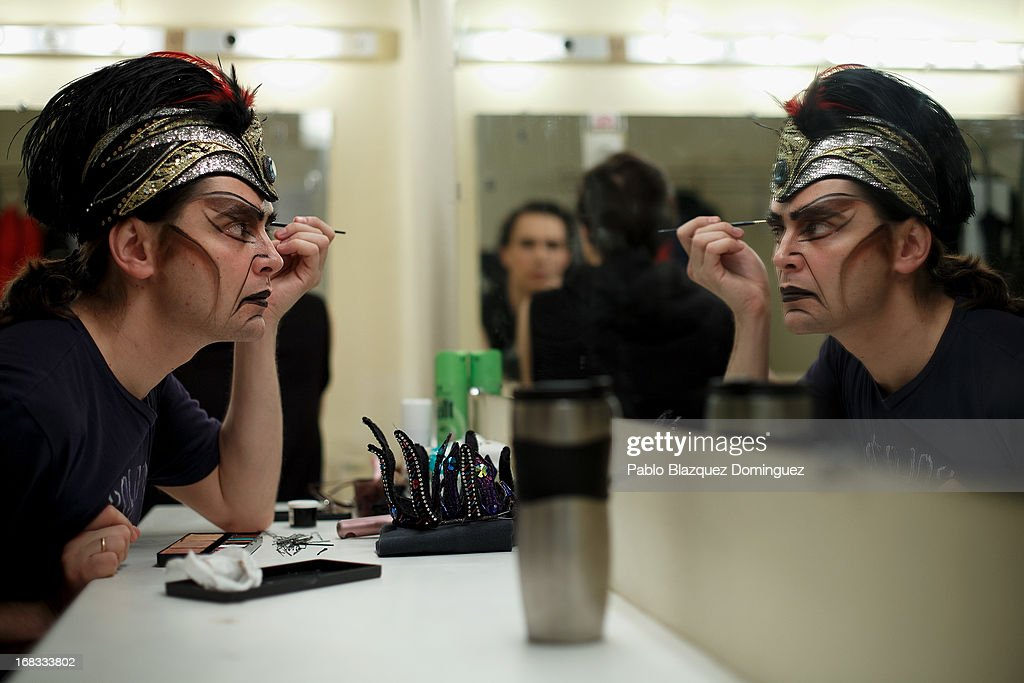 Dancer Timur Kinzikeyev of the Classical Russian Ballet applies make-up at backstage before a rehearsal of 'Swan Lake' at Nuevo Apolo Theatre on May 8, 2013 in Madrid, Spain.