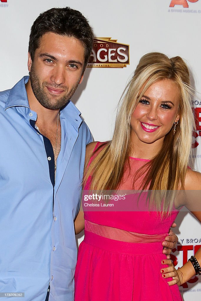 Dancer / TV personalities Dmitry Chaplin (L) and Chelsie Hightower arrive at the 'Sister Act' opening night premiere at the Pantages Theatre on July 9, 2013 in Hollywood, California.