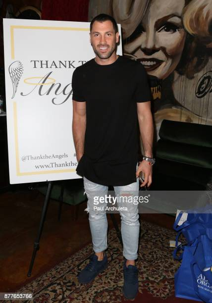 Dancer / TV Personality Maksim Chmerkovskiy attends the stuffing of the bags for the 'Thank The Angels Thanksgiving Charity' event at Lucky Strike...