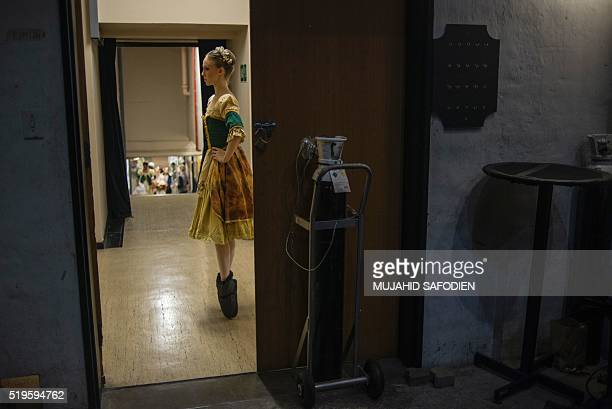 A dancer warms up backstage before performing during a dress rehearsal for the ballet Giselle at the Johannesburg Theatre on April 7 2016 Giselle...