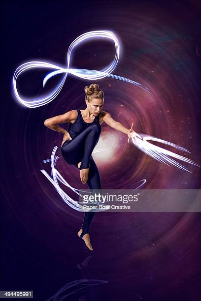 Dancer with strong light beams around her