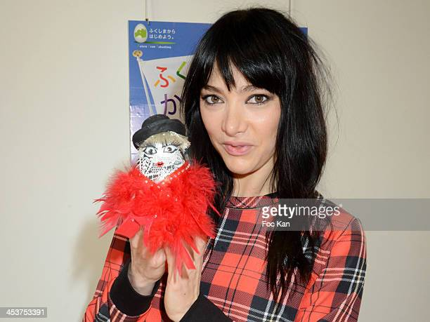 Dancer Zula from Crazy Horse poses with her puppet during The 'Solidarite Fukushima' Press Preview Of Traditional Dolls 'Okiagari Koboshi' In Tribute...
