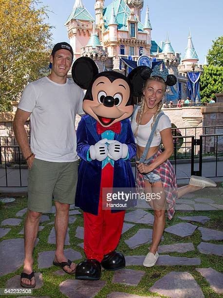 Dancer/Actress Julianne Hough and fiance Brooks Laich of the Toronto Maple Leafs visit Sleeping Beauty Castle with Mickey Mouse at Disneyland park on...